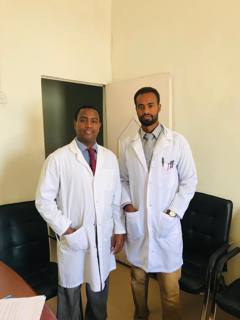 Yasin with With Dr. Abdirshid M. Shire, the Chancellor & Chief Scientific Officer of the Bureau of Forensic Science in Puntland.